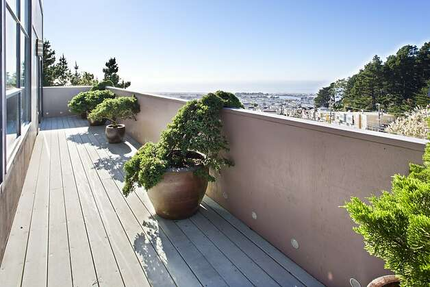 A wraparound deck is one of the features of the three-bedroom home. Photo: Steph Dewey, Reflex Imaging