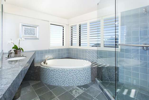 The master bathroom has a jacuzzi tub and stall shower. Photo: Steph Dewey, Reflex Imaging