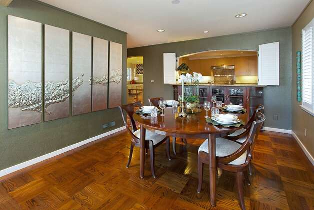 The dining room at 179 Mendosa Ave. has hardwood floors. Photo: Steph Dewey, Reflex Imaging
