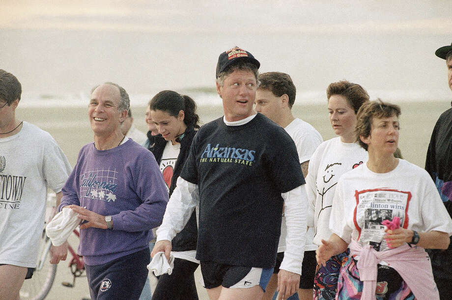 President-elect Bill Clinton is joined by fellow participants of the Renaissance Weekend during the second half of his run at Hilton Head Island, S.C., Dec. 31, 1992. Clinton and his family were vacationing in a private home on the island. Photo: Associated Press / Associated Press