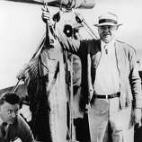 President Herbert Hoover poses with one of the five sailfish he caught on his vacation trip in Florida waters aboard the presidential boat Sequoia, Jan. 21, 1933.