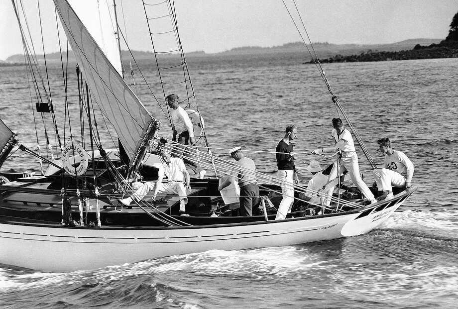 Activity aboard the Amberjack 11, with all hands busy at some appointed task, as the presidential vacation yacht sailed on June 26, 1933 in Penobscot Bay, Maine. The president's son,  James Roosevelt (dark sweater), is assisting his brother, John, to haul in the main sail.    Seated in extreme right in the stern of the craft is Franklin Jr.   At the wheel (with back to camera), between James and John, is President  Franklin Roosevelt. Photo: Associated Press / Associated Press