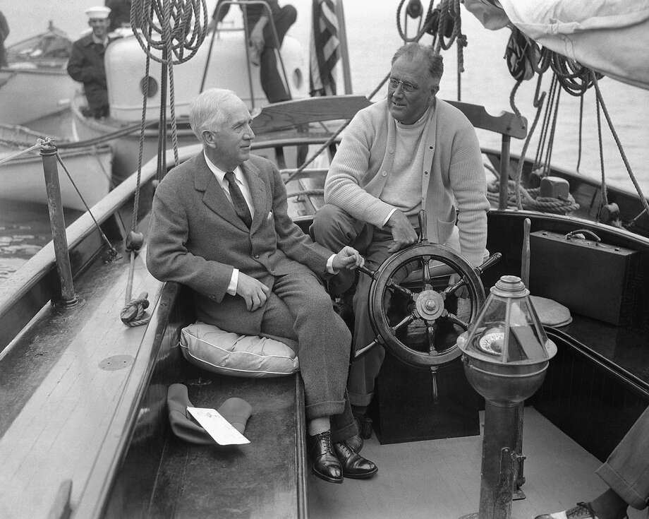 In this June 28, 1933, file photo, President Franklin D. Roosevelt talks with his Ambassador-at-Large Norman H. Davis about the Geneva Disarmament Conference, left, while vacationing aboard the Amberjack II at Lakeman Bay, Maine. Photo: Associated Press / Associated Press