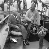 In this June 28, 1933, file photo, President Franklin D. Roosevelt talks with his Ambassador-at-Large Norman H. Davis about the Geneva Disarmament Conference, left, while vacationing aboard the Amberjack II at Lakeman Bay, Maine.