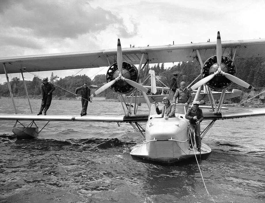 At regular intervals, Navy seaplanes delivered mail to President Franklin Roosevelt aboard his vacation boat cruising off the coast of Nova Scotia. One of the planes is seen about to leave Bar Harbor, Maine, with the presidential mail on July 20, 1936. Waving from the front cockpit is Hall Roosevelt, brother of Mrs. Roosevelt. Photo: Associated Press / Associated Press