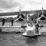 At regular intervals, Navy seaplanes delivered mail to President Franklin Roosevelt aboard his vacation boat cruising off the coast of Nova Scotia. One of the planes is seen about to leave Bar Harbor, Maine, with the presidential mail on July 20, 1936. Waving from the front cockpit is Hall Roosevelt, brother of Mrs. Roosevelt.