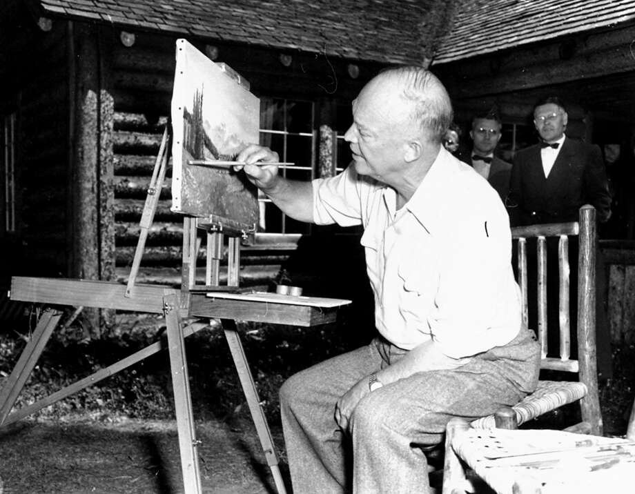 When he wasn't trout fishing or busy over the cabin's electric stove, Gen. Dwight D. Eisenhower devoted a good deal of his time to his oil painting during his vacation in the Colorado mountains.  On July 23, 1952, the Republican presidential nominee showed reporters six paintings he had completed since starting his vacation the week before. Photo: Associated Press / Associated Press