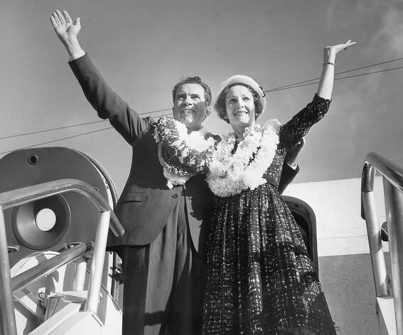 Vice President Richard Nixon and Mrs. Pat Nixon wave farewell just before taking off for Seattle, Aug. 5, 1960 in Honolulu, after two days of hectic campaigning in the Hawaiian Islands. Heavily draped in leis, the Nixons said they would be back some time for a vacation. Photo: Associated Press / Associated Press