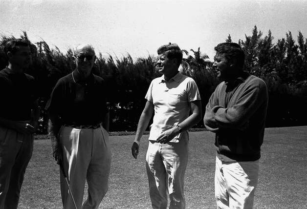 President Kennedy poses with his golfing partners on the first tee at the Palm Beach Country Club before starting off on a final round of golf to end his Easter vacation in Florida, April 4, 1961.  The foursome included, from left, his brother-in-law, Stephen Smith of Washington; his father, Joseph Kennedy; and another brother-in-law, actor Peter Lawford. Photo: Associated Press / Associated Press