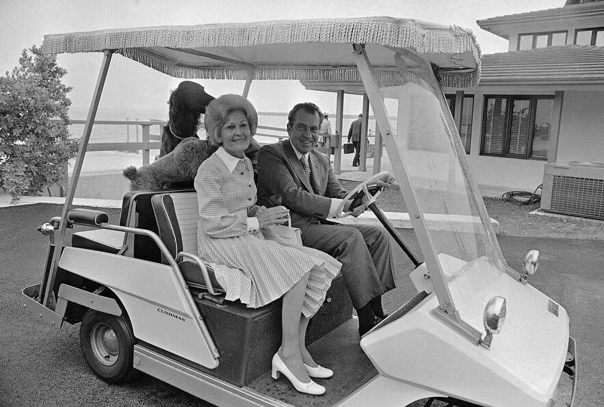 President Richard Nixon and Pat Nixon ride in a golf cart near their home in Key Biscayne, Fla. on J
