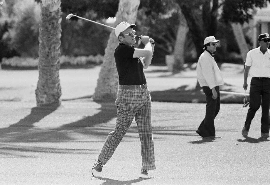President Gerald Ford has no trouble coming out of a sand trap at the Eldorado Country Club during a round of golf on March 31, 1975 in Palm Springs, Calif. Ford played with comedian Bob Hope during the round. Earlier  the president journeyed north to Bakersfield and the naval reserve at nearby Elk Hills for an inspection trip. Photo: Associated Press / Associated Press