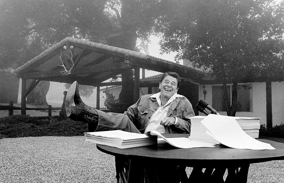 President Ronald Reagan shows his boot following the signing of his tax bill at his California vacation home, Rancho del Cielo, near Santa Barbara, Calif., Aug. 14, 1981. Photo: Associated Press / Associated Press