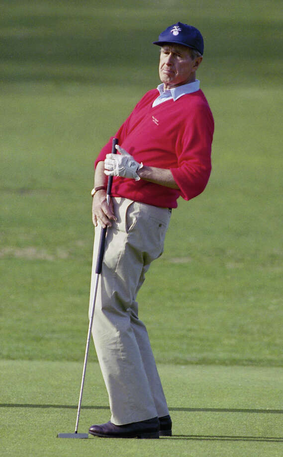 President George Bush reacts to missing a putt on the 18th hole of the golf course at Andrews Air Force Base, April 12, 1992.  Bush stopped to play golf at the course on his way back to the White House after spending the weekend at Camp David. Photo: Associated Press / Associated Press
