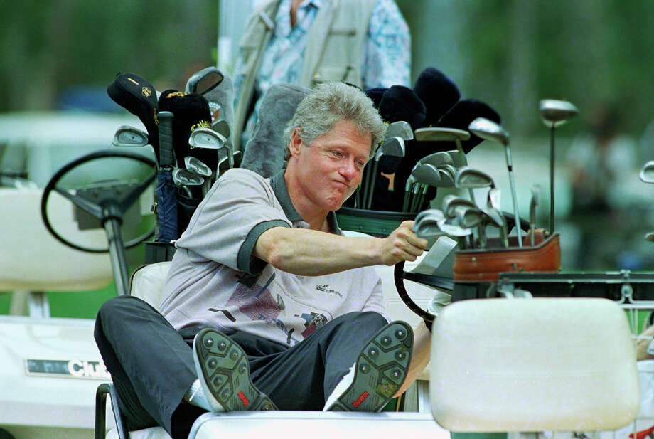 President Bill Clinton reacts as he looks at his golf score card during a golf match at the Farm Neck Golf Club in Oak Bluffs, Mass., on Martha's Vineyard, Aug. 22, 1993. The Clinton family was spending their vacation on the popular New England island. Photo: Associated Press / Associated Press