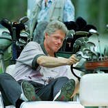 President Bill Clinton reacts as he looks at his golf score card during a golf match at the Farm Neck Golf Club in Oak Bluffs, Mass., on Martha's Vineyard, Aug. 22, 1993. The Clinton family was spending their vacation on the popular New England island.