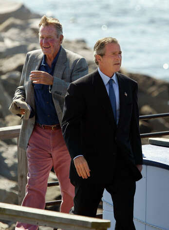President Bush and his father, former President Bush, left, walk up the ramp at a dock in Scarborough, Maine, where they campaigned on behalf of Sen. Susan Collins, R-Maine. The president made the half-hour trip by sea from his family's home at Kennebunkport, where he was visiting before starting vacation at his Crawford, Texas, ranch. Photo: Associated Press / Associated Press