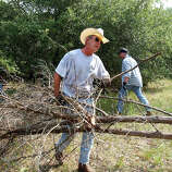 President Bush clears cedar at his 1,600-acre ranch in Crawford, Texas, Aug. 9, 2002.
