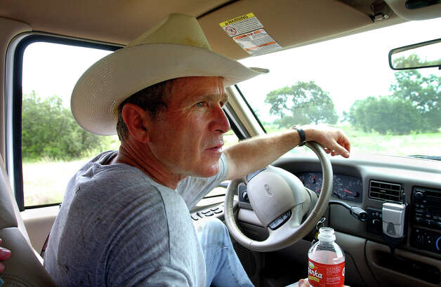 "President Bush drives his pickup truck at his ranch in Crawford, Texas, Aug. 9, 2002, where he was vacationing for nearly a month.  At Crawford, the president said, ""I'm able to clear my mind and it helps me put it all in perspective.""  Photo: Associated Press / Associated Press"