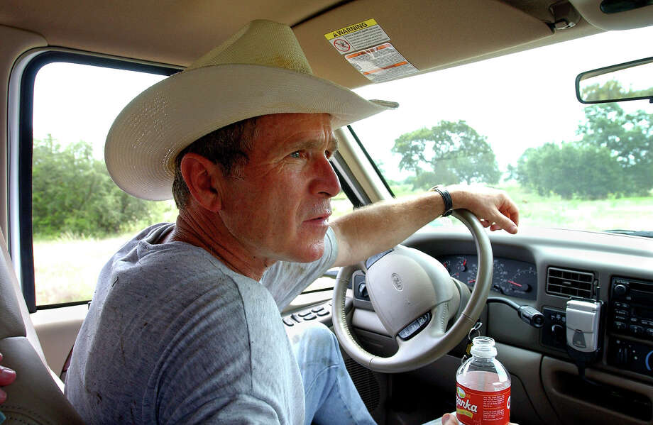 "President Bush drives his pickup truck at his ranch in Crawford, Texas, Friday, Aug. 9, 2002, where he is vacationing for nearly a month.  At Crawford, the President said, ""I'm able to clear my mind and it helps me put it all in perspective"". (AP Photo/The White House, Eric Draper) Photo: Associated Press / Associated Press"