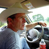 "President Bush drives his pickup truck at his ranch in Crawford, Texas, Aug. 9, 2002, where he was vacationing for nearly a month.  At Crawford, the president said, ""I'm able to clear my mind and it helps me put it all in perspective."""