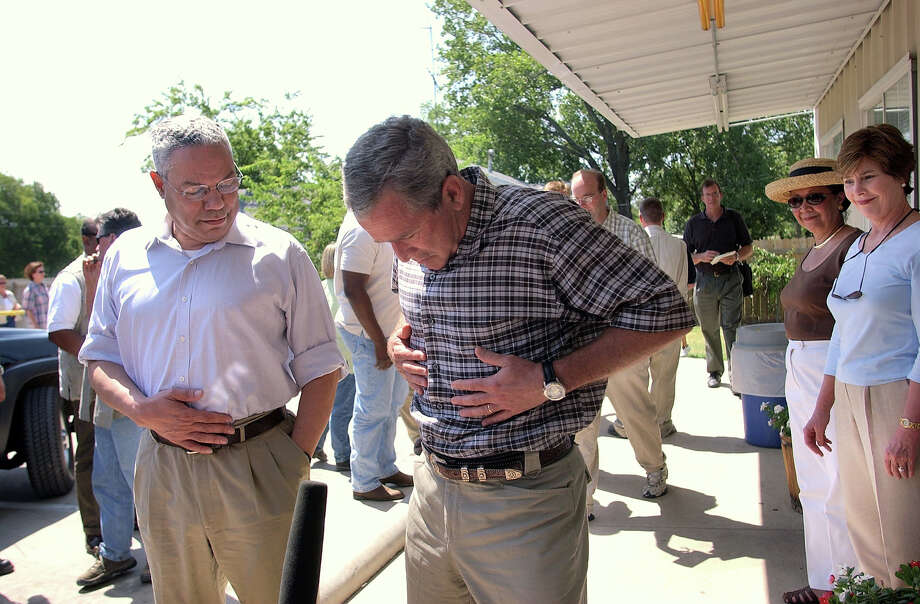 In this Aug. 6, 2003, file photo, President George W. Bush reacts to a reporter's question as to whether he has gained weight on his vacation, prior to entering the Coffee Station restaurant in Crawford, Texas. With him are Secretary of State Colin Powell, left, first lady Laura Bush, far right, and Alma Powell, Colin Powell's wife, second right. Bush was criticized for spending nearly 500 days at his ranch in Crawford during his two terms in office. He was there in August 2001 when he received a CIA briefing paper warning of al-Qaida's intentions to strike the United States — about a month before the Sept. 11 attacks would occur. In 2005, he remained on vacation after Hurricane Katrina swamped New Orleans and devastated the Gulf Coast. Photo: Associated Press / Associated Press