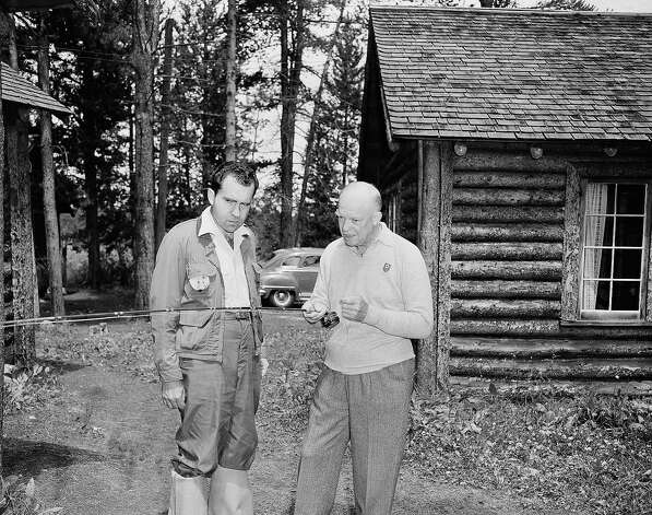 The Republican presidential nominee, Gen. Dwight D. Eisenhower (right), shows his running mate, California Sen. Richard M. Nixon, how to cast for fish and bring them in during an interlude at Eisenhower's vacation retreat near Fraser, Colo. on July 27, 1952.   Ike ended his vacation the next day when he and Nixon, GOP vice presidential nominee, conferred on campaign strategy. Photo: Associated Press / Associated Press