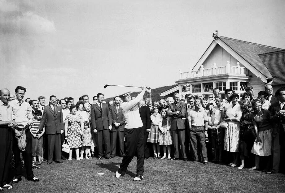 For once in his European tour, President Dwight  Eisenhower wasn't the center of attention of spectators, losing out on Sept. 4, 1959 to the golf ball he hit from the first tee at Turnberry Golf Course in Scotland.  The president, who arrived earlier in the day from Paris for a few days vacation before returning to the United States, stayed at Culzean Castle. Photo: Associated Press / Associated Press