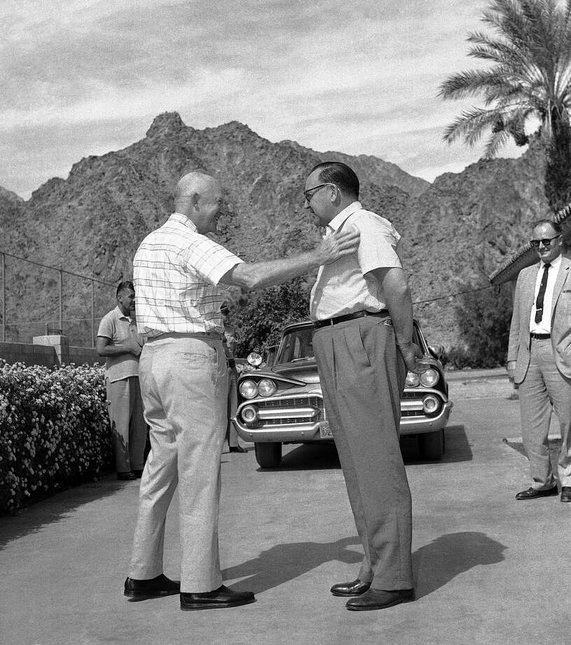 With a friendly pat on the shoulder, President Eisenhower says goodbye to California Gov. Edmund (Pat) Brown at the end of a courtesy call Brown paid to the president on Oct. 5, 1959 in La Quinta, Calif. The meeting was at the desert home where Ike was vacationing and trying to get rid of a cold. Both Eisenhower and Brown played golf that day, but on different courses. Brown was a Democrat and considered a presidential possibility in 1960. Photo: Associated Press / Associated Press