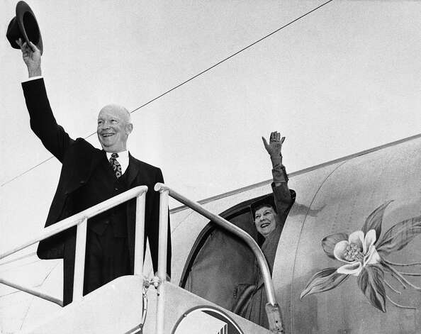 "President Dwight Eisenhower and Mrs.  Mamie Eisenhower wave to a small crowd as they leave for Washington, ending their vacation at nearby Augusta National Golf Club on Nov. 23, 1959. At right is the ""Columbine Flower"" which is the state flower of Colorado and after which the plane is named. Photo: Associated Press / Associated Press"