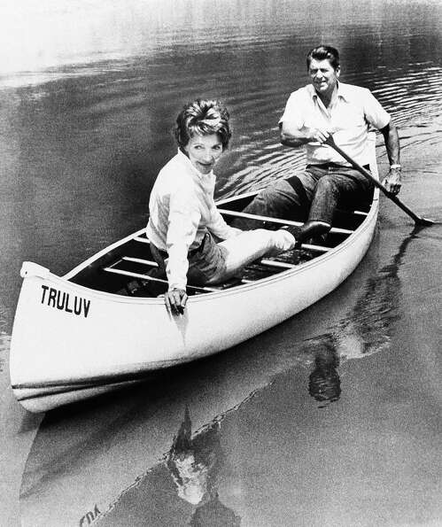 Ronald Reagan takes his wife Nancy for a canoe ride on a pond at their mountaintop ranch near Santa