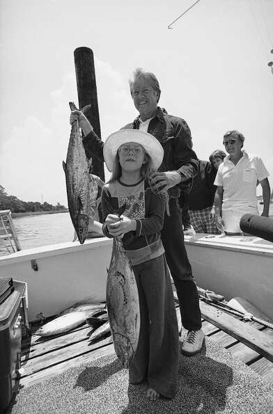 President Jimmy Carter and daughter Amy show off part of their catch from a 12-hour fishing trip, Ma