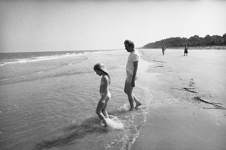 President Jimmy Carter and daughter Amy wade into the Atlantic Ocean, May 30, 1977, at Sea Island, Ga.  The president took Amy swimming late in the afternoon.  Earlier in the day they had seen Mrs. Carter off on her seven-nation tour of Latin America. Photo: Associated Press / Associated Press