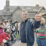 Vice President George Bush fields another question during a news conference in front of his Kennebunkport, Maine home, May 27, 1988, with his wife, Barbara, right, at his side. Bush, who was at his vacation retreat home for close to a week, said he wasn't bothered by polls that give Michael Dukakis a double-digit lead.