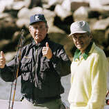 President George H. Bush gives a thumbs-up to photographers from his boat Fidelity while cruising the harbor in Wells, Maine, on Sept. 2, 1989.  The president spent Labor Day weekend at his vacation home in Kennebunkport, Maine.  Man at right is unidentified.
