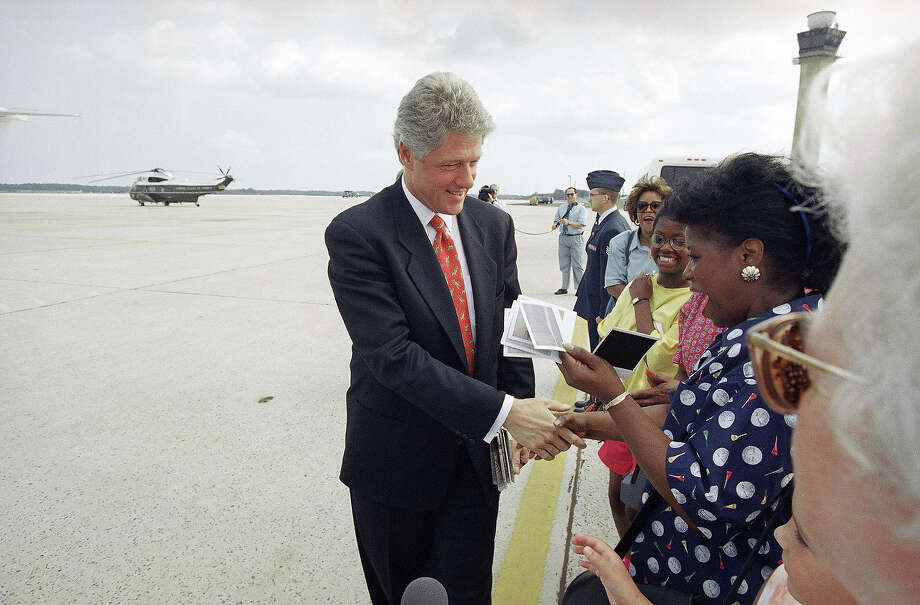 President Bill Clinton greets unidentified visitors to Andrew Air Force Base, Md., Aug. 19, 1993, before his departure for Martha's Vineyard. Clinton and his family spent 11 days vacationing on the Massachusetts island. Photo: Associated Press / Associated Press