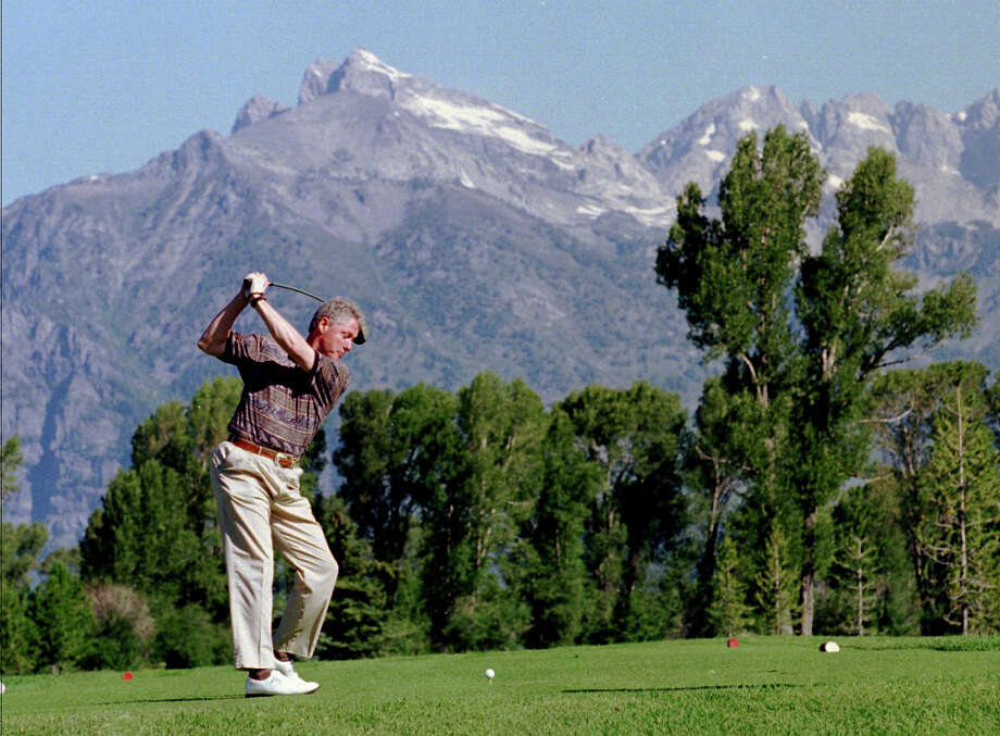 President Clinton tees off on the first hole at the Jackson Hole Golf and Tennis Club, Aug. 16, 1995, in Jackson Hole, Wyo. The president's mountain vacation in the Grand Tetons got off to a rocky start after hitting his first shot too high and too far to the left. Photo: Associated Press / Associated Press