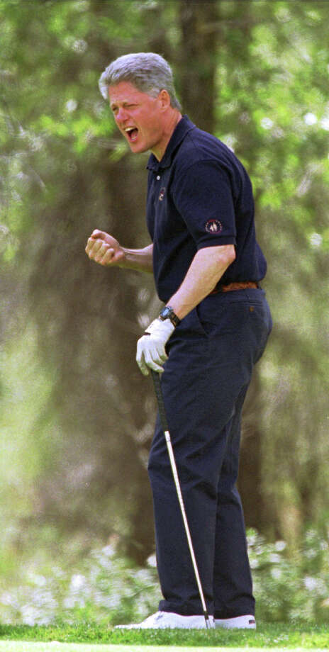 President Clinton reacts to missing a putt on the ninth green Aug. 17, 1995, outside Jackson Hole, Wyo. This was the president's second day of golf while on vacation. He played 37 holes the day before. Photo: Associated Press / Associated Press
