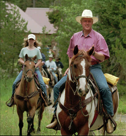 President Clinton and daughter Chelsea go for a horseback ride at the J.Y. Ranch on Aug. 21, 1995, outside Jackson, Wyo.  The president's horse was named Buster and Chelsea rode Peanut. The ranch was owned by the Rockefeller family, the Clintons' hosts in Jackson Hole.  Photo: Associated Press / Associated Press