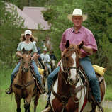 President Clinton and daughter Chelsea go for a horseback ride at the J.Y. Ranch on Aug. 21, 1995, outside Jackson, Wyo.  The president's horse was named Buster and Chelsea rode Peanut. The ranch was owned by the Rockefeller family, the Clintons' hosts in Jackson Hole.