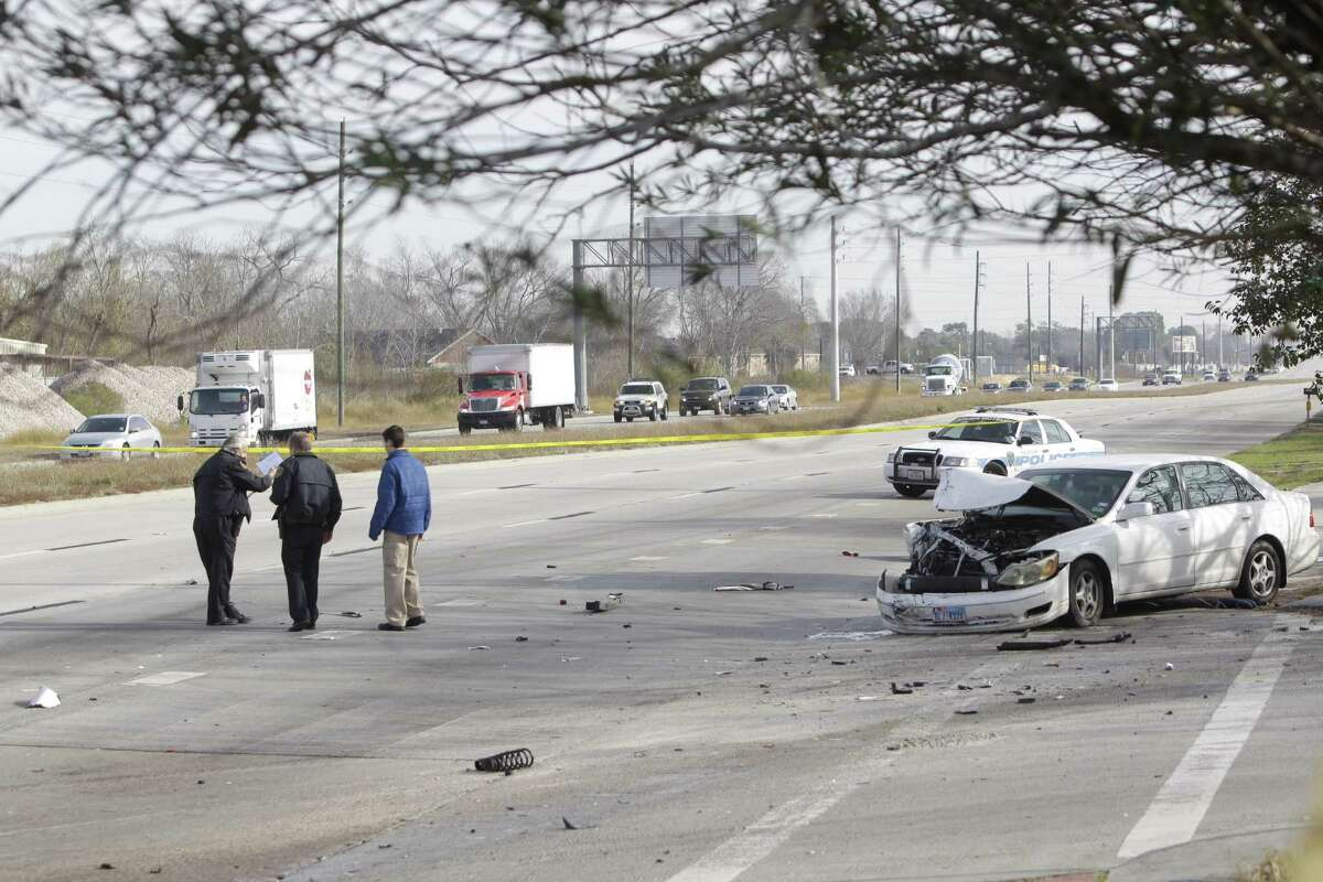 Wreck at S Main and Zavalla showing one of the three vehicles involved, a Camry (not shown) was driving south on S Main and crossed the median hitting oncoming traffic Monday, Jan. 7, 2013. HPD Lt M J Parrie said the driver of one of the vehicles hit by Camry was dead on the scene.