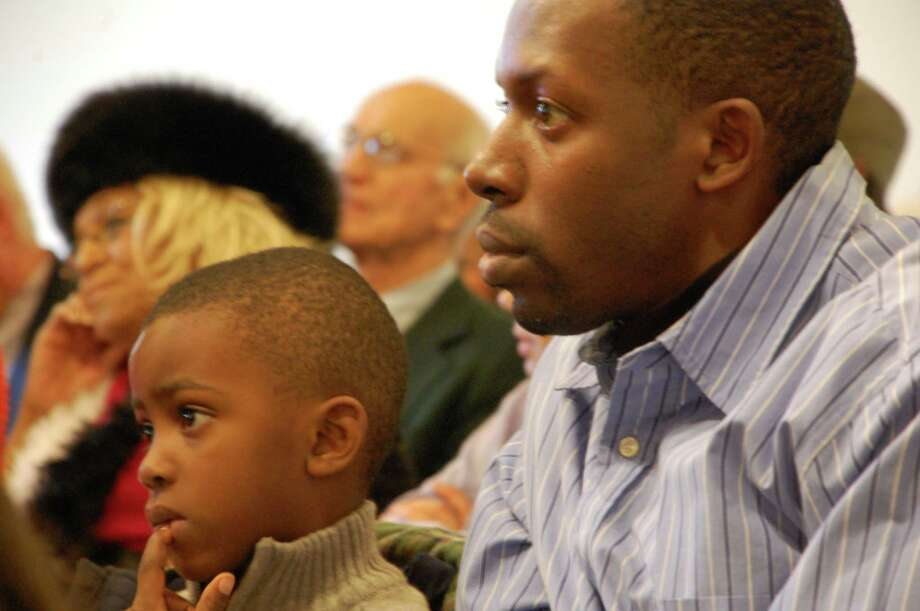 """Kenneth Franklin, of Bridgeport, and his son Bryson, 5, were on hand for Sunday's celebration, """"Let Freedom Ring!"""" marking the 150th anniversary of the Emancipation Proclamation at the Fairfield Museum and History Center.   Fairfield CT 1/6/13 a rapt audience for the """"Let Freedom Ring!"""" celebration Sunday at The Fairfield Museum and History Center. Photo: Jarret Liotta / Fairfield Citizen contributed"""