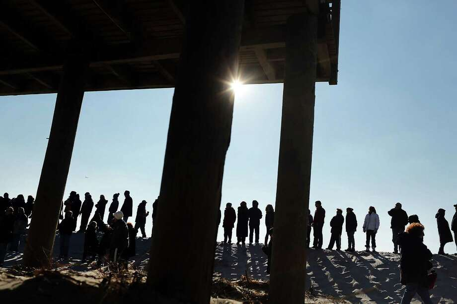 """LONG BEACH, NY - JANUARY 05: Hundreds of residents of Long Beach, Long Island attend a """"goodbye"""" ceremony for the town's historic wooden boardwalk, which was badly damaged in Hurricane Sandy, on January 5, 2013 in Long Beach, New York. Residents were given a final opportunity to say goodbye to the landmark boardwalk and to take a piece home before it was to be demolished and eventually replaced with a new boardwalk. The demolition is expected to take about a month. Photo: Spencer Platt, Getty Images / 2013 Getty Images"""