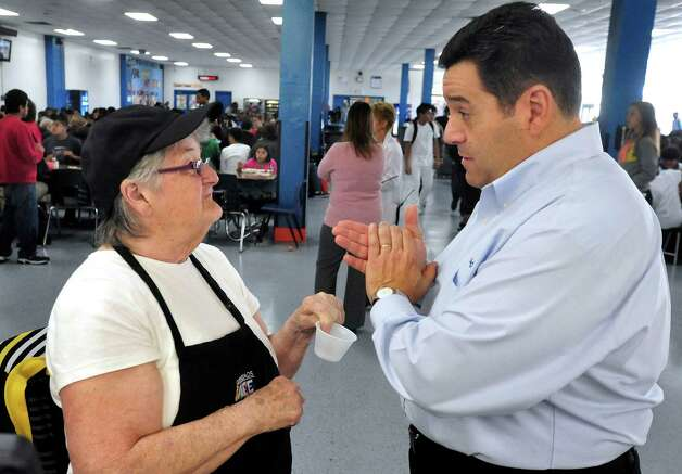 Cafeteria worker Peg Dyer talks with Barry Mollengarden, general manager for Sodexo, the food service company used by Danbury Public Schools, at the high school Thursday, Oct. 11, 2012. Photo: Michael Duffy / The News-Times