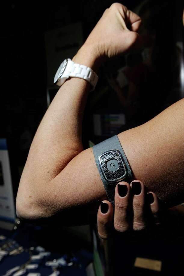 LAS VEGAS, NV - JANUARY 06:  A Body Media arm band is on display during a press event at the Mandalay Bay Convention Center for the 2013 International CES on January 6, 2013 in Las Vegas, Nevada. The arm band is designed to record your physical activities and will be availble this summer. CES, the world's largest annual consumer technology trade show, runs from January 8-11 and is expected to feature 3,100 exhibitors showing off their latest products and services to about 150,000 attendees. Photo: David Becker, Getty Images / 2013 Getty Images