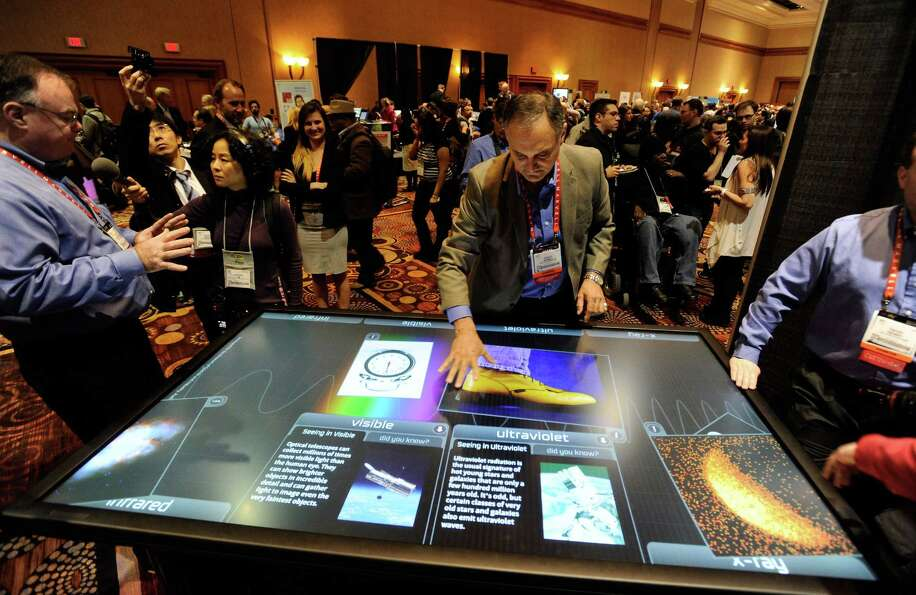LAS VEGAS, NV - JANUARY 06:  Diego Romeu of 3M Touch Systems uses an 84 inch touch table during a pr