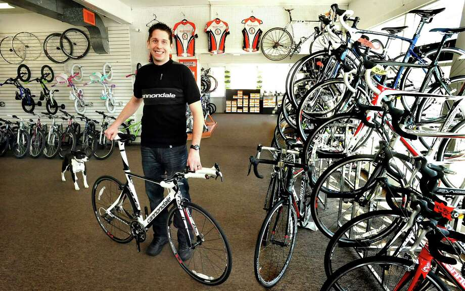 Shawn Emmerson holds a Cannondale Slice in his Brookfield business, The Bicycle Center Monday, Jan. 7, 2013. Photo: Michael Duffy