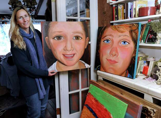 Scarlett Lewis, of Sandy Hook holds a paintings that she made of her two sons, Jesse and JT. Photo: Carol Kaliff / The News-Times