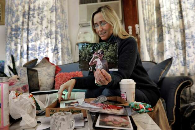 Scarlett Lewis, of Sandy Hook, looks through photographs of her, Jesse, who was killed in the Sandy Hook Elementary School shootings on Dec. 14, 2012. Photo: Carol Kaliff / The News-Times