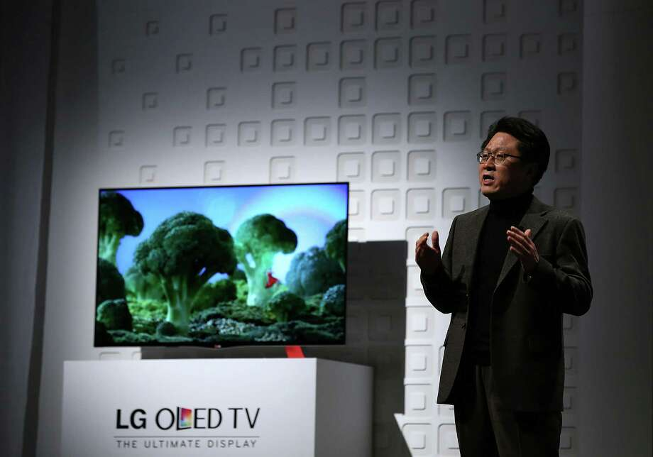 Dr. Skott Ahn, LG Electronics Chief Technology Officer, speaks during a news conference Monday. Photo: Justin Sullivan, Getty Images / 2013 Getty Images