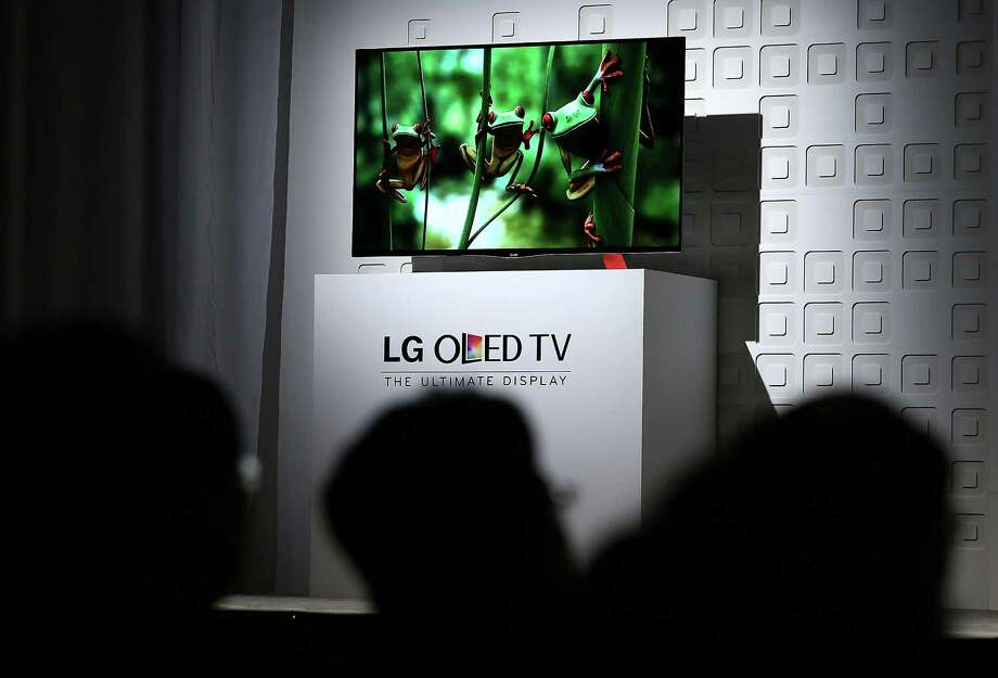 The new LG OLED TV is displayed during an LG press conference. The set is expected to be priced at $12,000. Photo: Justin Sullivan, Getty Images / 2013 Getty Images